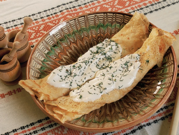 Crepes with sour cream and fresh cow cheese